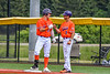"""Cortland Crush Brandon """"Buzz"""" Shirley (18) talking with the Crush First Base Coach against the Hornell Dodgers in New York Collegiate Baseball League action at Gutchess Lumber Sports Complex in Cortland, New York on Saturday, June 19, 2021. Hornell won 8-3"""