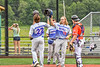 Hornell Dodgers players congratulate Levi Hall (22) for his Home Run against the Cortland Crush in New York Collegiate Baseball League action at Gutchess Lumber Sports Complex in Cortland, New York on Saturday, June 19, 2021. Hornell won 8-3