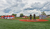 Cortland Crush and Hornell Dodgers players standing for the National Anthem before playing a New York Collegiate Baseball League game at Gutchess Lumber Sports Complex in Cortland, New York on Saturday, June 19, 2021.