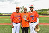 Cortland Crush players Lawrence Hamilton (34) and Alexis Castillo (26) with a Dad at Gutchess Lumber Sports Complex in Cortland, New York on Saturday, June 19, 2021.