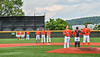 Cortland Crush players standing for the National Anthem before playing a New York Collegiate Baseball League game at Gutchess Lumber Sports Complex in Cortland, New York on Saturday, June 19, 2021.