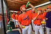 """Cortland Crush players Griffin Snyder (29) and Brandon """"Buzz"""" Shirley (18) chowing down on burgers before playing the Hornell Dodgers in a New York Collegiate Baseball League game at Gutchess Lumber Sports Complex in Cortland, New York on Saturday, June 19, 2021."""