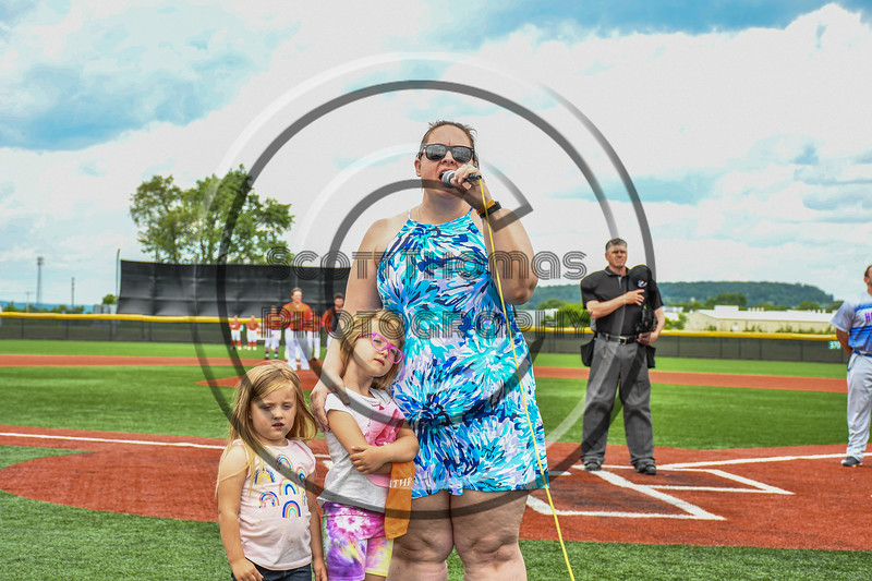 Melissa Simmons of the Guthrie Cortland Medical Center sang the National Anthem before a Cortland Crush New York Collegiate Baseball League game at Gutchess Lumber Sports Complex in Cortland, New York on Saturday, June 19, 2021.