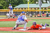 Cortland Crush Zach Marriott (5) gets back to First Base before the ball against the Hornell Dodgers in New York Collegiate Baseball League action at Gutchess Lumber Sports Complex in Cortland, New York on Saturday, June 19, 2021. Hornell won 8-3