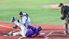 Cortland Crush Lawrence Hamilton (34) slides into Home Plate and beats the tag by Syracuse Salt Cats Catcher Fausto Lopez (12) to score a run in New York Collegiate Baseball League action at OCC Turf Field in Syracuse, New York on Tuesday, June 22, 2021. Cortland won 6-4.