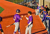 """Cortland Crush Javier Rosa (3) greets Brandon """"Buzz"""" Shirley (18) after he scored a run against the Syracuse Salt Cats in New York Collegiate Baseball League action at OCC Turf Field in Syracuse, New York on Tuesday, June 22, 2021. Cortland won 6-4."""