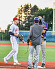 Cortland Crush Michael Breen (6) being congratulated for getting to First Base against the Syracuse Salt Cats in New York Collegiate Baseball League action at OCC Turf Field in Syracuse, New York on Tuesday, June 22, 2021. Cortland won 6-4.