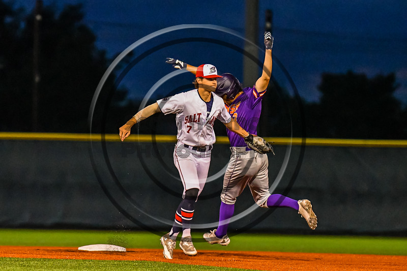 Cortland Crush Javier Rosa (3) is tagged out by Syracuse Salt Cats Craig Alleyne (7) in New York Collegiate Baseball League action at OCC Turf Field in Syracuse, New York on Tuesday, June 22, 2021. Cortland won 6-4.