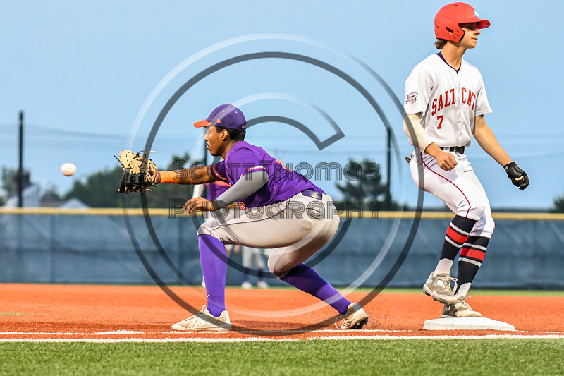 Cortland Crush First Baseman Alexis Castillo (26) keeping Syracuse Salt Cats Craig Alleyne (7) on the bag in New York Collegiate Baseball League action at OCC Turf Field in Syracuse, New York on Tuesday, July 6, 2021. Game ended in a 3-3 tie.