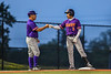Cortland Crush Manager Bill McConnell congratulates Javier Rosa (3) for legging out a Triple against the Syracuse Salt Cats in New York Collegiate Baseball League action at OCC Turf Field in Syracuse, New York on Tuesday, July 6, 2021. Game ended in a 3-3 tie.
