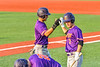Cortland Crush Jason Boule (7) congraulates Nicholas Pastore (1) for his run scored against the Syracuse Salt Cats in New York Collegiate Baseball League action at OCC Turf Field in Syracuse, New York on Tuesday, July 6, 2021. Game ended in a 3-3 tie.
