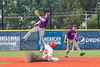 Cortland Crush Javier Rosa (3) catches the ball but unable to make the tag on Syracuse Salt Cats Patrick Maybach (16) in New York Collegiate Baseball League action at OCC Turf Field in Syracuse, New York on Tuesday, July 6, 2021. Game ended in a 3-3 tie.