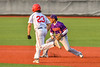 Cortland Crush Javier Rosa (3) fields the ball and tosses it to Second Base for the out against Syracuse Salt Cats James Coyne (23) in New York Collegiate Baseball League action at OCC Turf Field in Syracuse, New York on Tuesday, July 6, 2021. Game ended in a 3-3 tie.