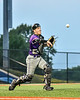 Cortland Crush Catcher Matthew Ward (20) fields a bunt and throws the Syracuse Salt Cats runner out at First Base in New York Collegiate Baseball League action at OCC Turf Field in Syracuse, New York on Tuesday, July 6, 2021. Game ended in a 3-3 tie.