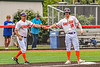 """Cortland Crush Manager Bill McConnell congratulates Brandon """"Buzz"""" Shirley (18) for reaching Third Base against the Mansfield Destroyers during the New York Collegiate Baseball League Jamboree at Wallace Field in Cortland, New York on Saturday, July 10, 2021. Cortland won 2-1."""