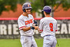 Cortland Crush Michael Breen (6) is congratulated for reaching First Base against the Mansfield Destroyers during the New York Collegiate Baseball League Jamboree at Wallace Field in Cortland, New York on Saturday, July 10, 2021. Cortland won 2-1.