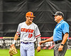 """Cortland Crush Brandon """"Buzz"""" Shirley (18) talking with the Infield Umpire during the New York Collegiate Baseball League Jamboree at Wallace Field in Cortland, New York on Saturday, July 10, 2021. Cortland won 2-1."""