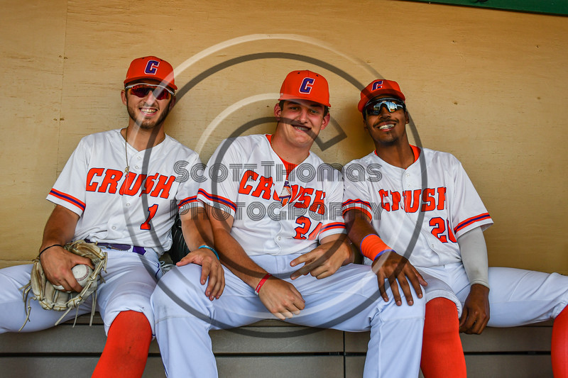 Cortland Crush players Nicholas Pastore (1), Justin DelVecchio (24) and Alexis Castillo (26) in the Dugout before p laying the Dansville Gliders in a the New York Collegiate Baseball League Jamboree game at Gutchess Lumber Sports Complex in Cortland, New York on Saturday, July 10, 2021.
