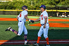 Cortland Crush Manager Bill McConnell congratulates Zach Marriott (5) after his Home Run against the Dansville Gliders during the New York Collegiate Baseball League Jamboree at Gutchess Lumber Sports Complex in Cortland, New York on Saturday, July 10, 2021. Cortland won 2-0.