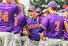 Cortland Crush Manager Bill McConnell congratulates Pitcher Garrett Bell (10) for closing out the game against the Syracuse Salt Cats in New York Collegiate Baseball League action on Leo Pinckney Field at Falcon Park in Auburn, New York on Sunday, July 18, 2021. Cortland won 4-3.
