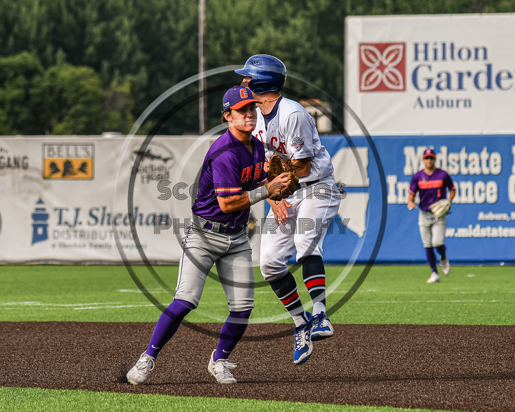 Cortland Crush Michael Breen (6) tags the Syracuse Salt Cats runner out in New York Collegiate Baseball League action on Leo Pinckney Field at Falcon Park in Auburn, New York on Sunday, July 18, 2021. Cortland won 4-3.