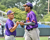 Cortland Crush Manager Bill McConnell congratulates Alexis Castillo (26) after his catch against the Syracuse Salt Cats in New York Collegiate Baseball League action on Leo Pinckney Field at Falcon Park in Auburn, New York on Sunday, July 18, 2021. Cortland won 4-3.