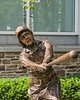 """""""Woman at Bat"""" statue found in Cooper Park, outside the Baseball Hall of Fame in Cooperstown, New York on Friday, July 23, 2021."""
