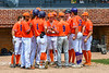 Orange Crush Assistant Coach Colin Dower (9) and Player Manager John Davis (32) meet with their team before playing the Purple Crush at Doubleday Field in Cooperstown, New York on Friday, July 23, 2021.