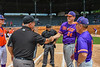 Purple Crush Player Manager Justin DelVecchio (24) greets the Umpires at Doubleday Field in Cooperstown, New York on Friday, July 23, 2021.