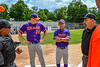 Purple Crush Player Manager Justin DelVecchio (24) and Manager Bill McConnell listen to the ground rules from the Umpire at Doubleday Field in Cooperstown, New York on Friday, July 23, 2021.