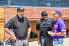 Manager Bill McConnell talking with the Umpires before the Orange/Purple Crush game at Doubleday Field in Cooperstown, New York on Friday, July 23, 2021.
