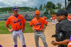 Orange Crush Player Manager John Davis (32) and Assistant Coach Colin Dower (9) listen to the ground rules from the Umpire at Doubleday Field in Cooperstown, New York on Friday, July 23, 2021.