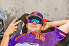 """Cortland Crush Brandon """"Buzz"""" Shirley (18) relaxing in the Bullpen against the Syracuse Salt Cats in New York Collegiate Baseball League playoff action at OCC Turf Field in Syracuse, New York on Wednesday, July 28, 2021. Cortland won 12-0."""