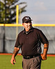 Infield Umpire working the New York Collegiate Baseball League playoff game between Cortland Crush and Syracuse Salt Cats at OCC Turf Field in Syracuse, New York on Wednesday, July 28, 2021.