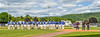 Cortland Crush and Hornell Dodgers players standing for the National Anthem before a New York Collegiate Baseball League Championship playoff game in Hornell, New York on Saturday, July 31, 2021.
