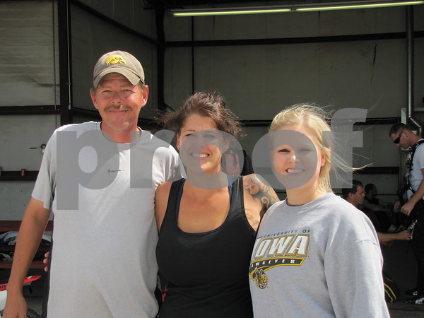 Stan Wright, Stacy Cox, and Katelynn Cox, all from Britt, pose after their tandem jump.