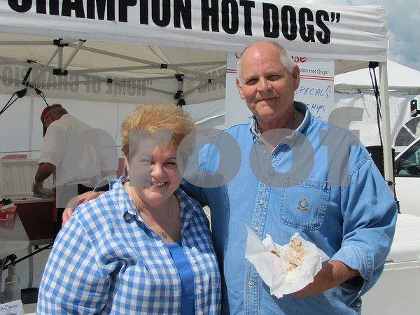 Denise and Paul Halverson enjoy a chili dog at Halvey's Dog House at the skydiving event.