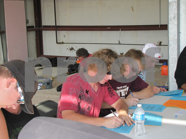 Tandem jumpers fill out all the necessary paper work prior to their jump.