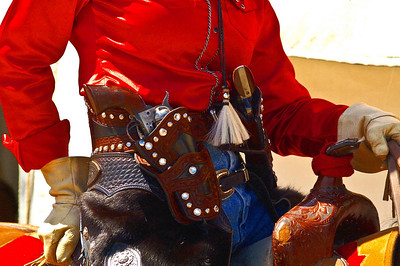 A Cowgirl at a western reenactment wearing her two six guns.