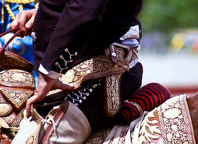 A Vaquero riding in a Mexican Charro (Rodeo)