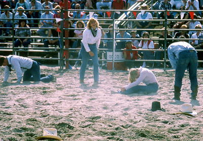 #2 of 4  The wild horse has not only taken out one of the cowgirls, but a rodeo clown and has made his escape leaving everone, literally, in the dust.