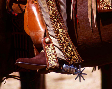 Vaquero riding in a Mexican Charro (Rodeo).