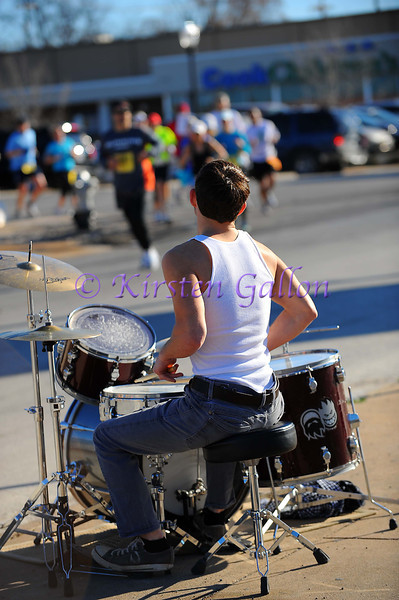 Tyler Hughes keeps the beat and entertains the runners as they pass one of the water stations.