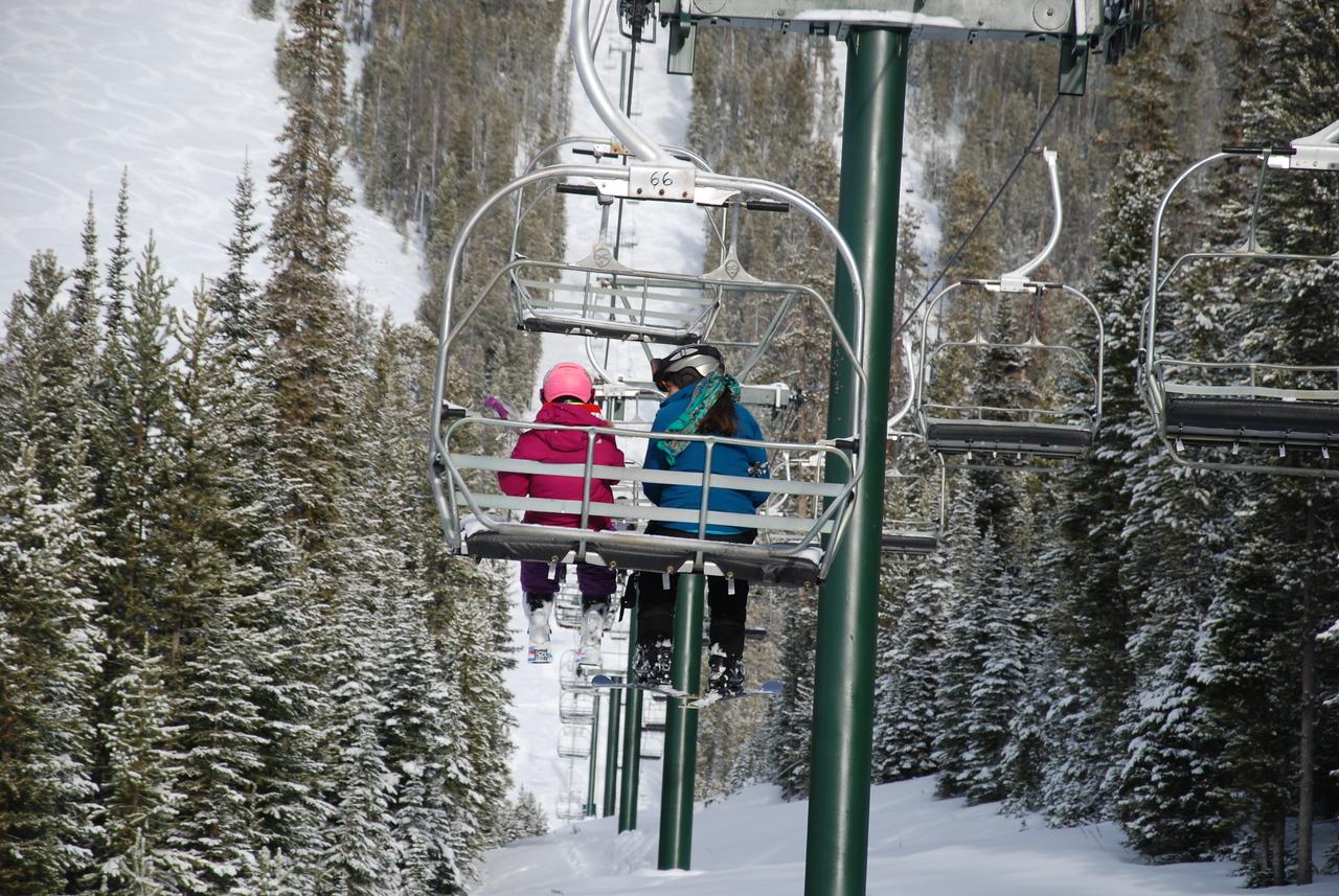 Anya and Christina share a chair at Ski Discovery. Jan 2017.