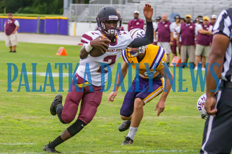 Crescent City senior Naykee Scott (2) keeps the ball and rambles across the goal line in the first quarter for the Raiders second score in the game against Union County on Friday night in a preseason matchup. Fran Ruchalski/Palatka Daily News
