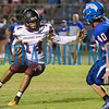 Crescent City kicker Christian Lopez (14) picks up the ball after a bad snap and tries to get downfield in the second half. Fran Ruchalski/Palatka Daily News