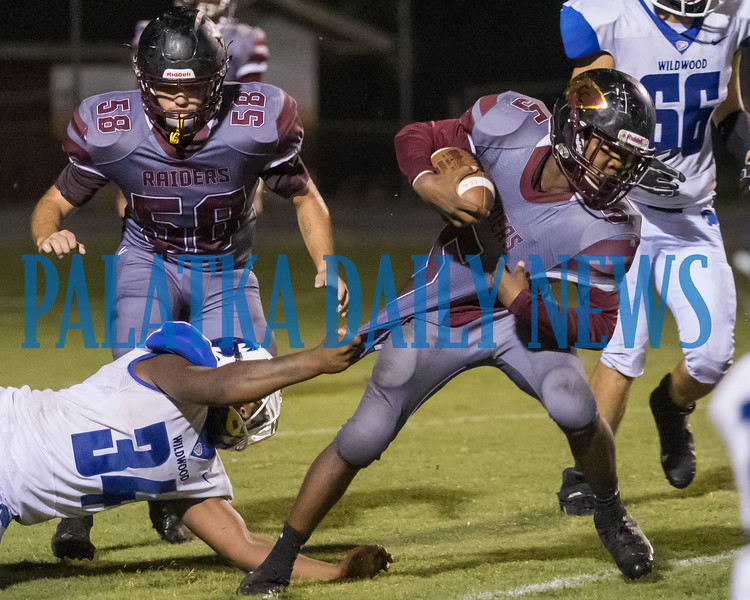 Raiders running back Naykeem Scott (5) can't be stopped by a grab of his jersey as he carries the ball in the third quarter in their game with Wildwood. Fran Ruchalski/Palatka Daily News