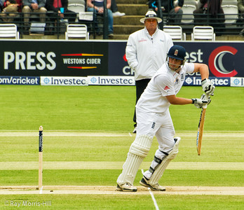Jonathan Trott is caught behind for 13