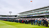 The crowd are allowed on the outfield during the lunch interval