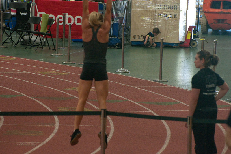 Coach with Christy warming up for the thruster wod.